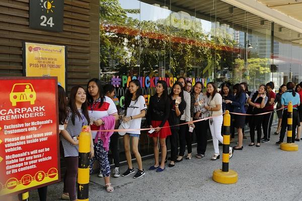 A long Joy-ful line outside a McDonald's store small